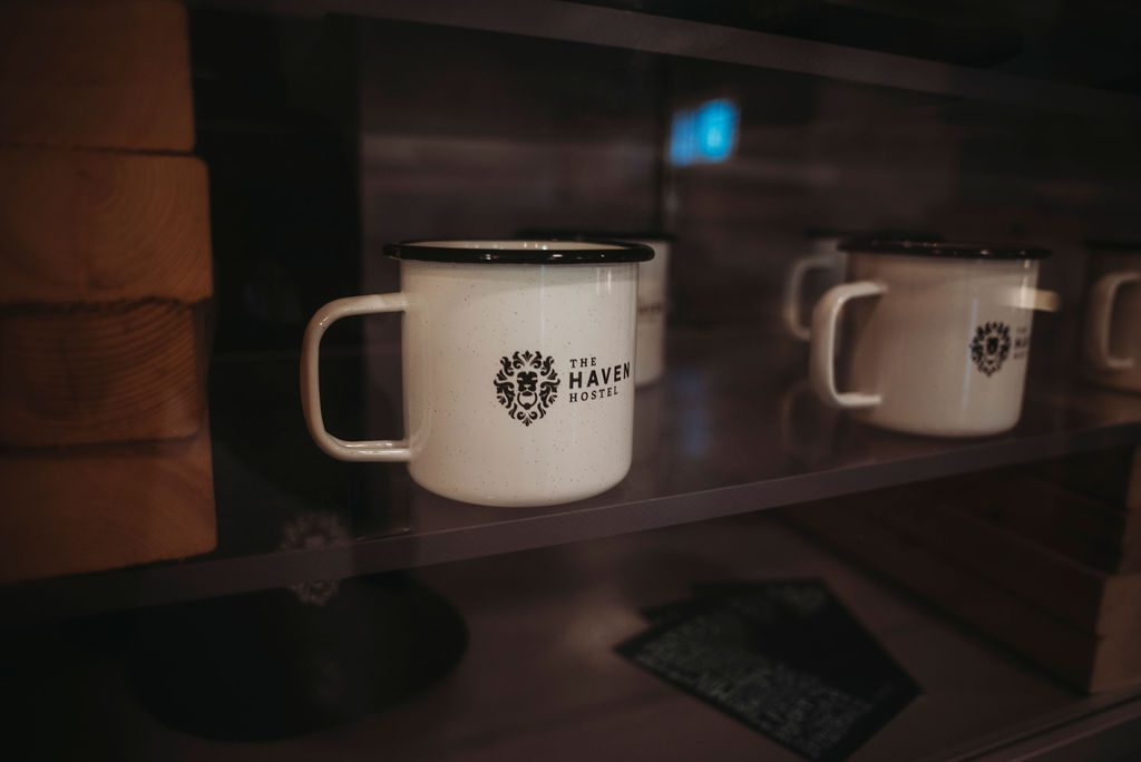 the haven hostel camper mugs created by impact promotions